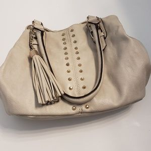 Call it spring cream colored hobo with gold studs